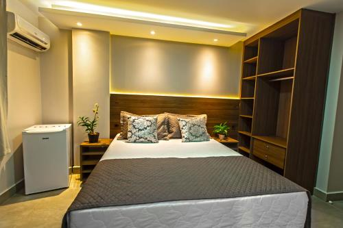 A bed or beds in a room at Hotel Flat Concept