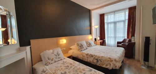 Ein Bett oder Betten in einem Zimmer der Unterkunft Hotel Bor Scheveningen