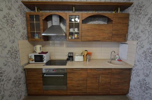 Кухня или мини-кухня в L-Apart