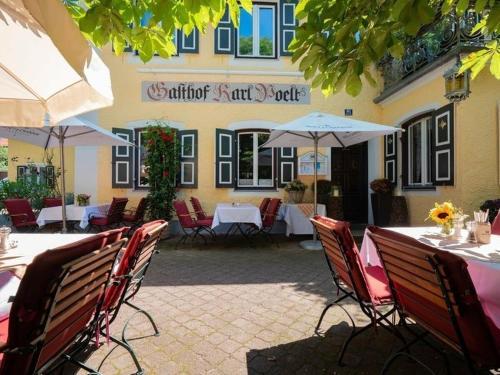 Ein Restaurant oder anderes Speiselokal in der Unterkunft Gasthaus Poelt