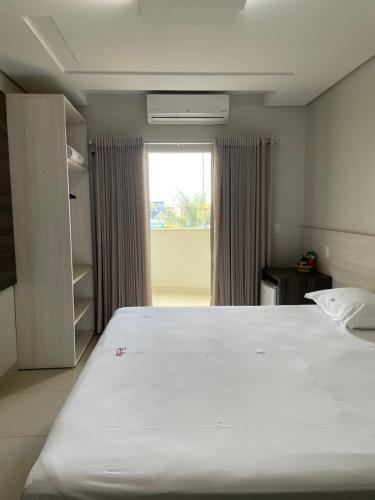 Cama ou camas em um quarto em Tezla Hotel