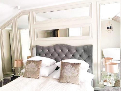 Łóżko lub łóżka w pokoju w obiekcie Zajazd Ryś