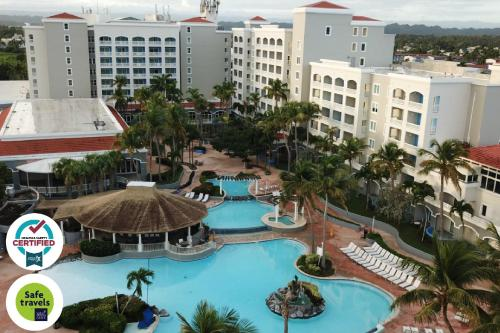 A view of the pool at Embassy Suites by Hilton Dorado del Mar Beach Resort or nearby