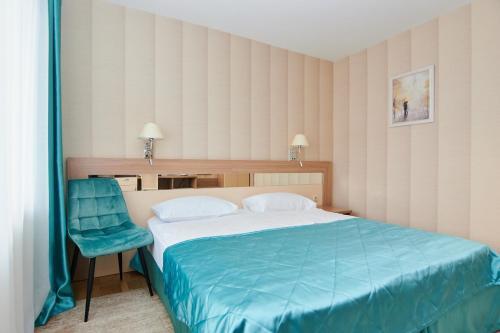 Кровать или кровати в номере Отель Сыктывкар