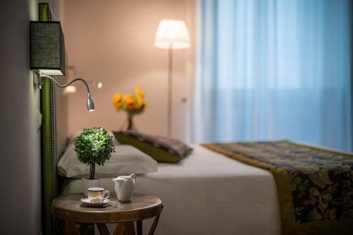 Letto o letti in una camera di Hotel del Corso