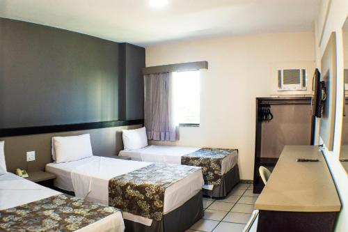 A bed or beds in a room at Nacional Inn Recife Aeroporto