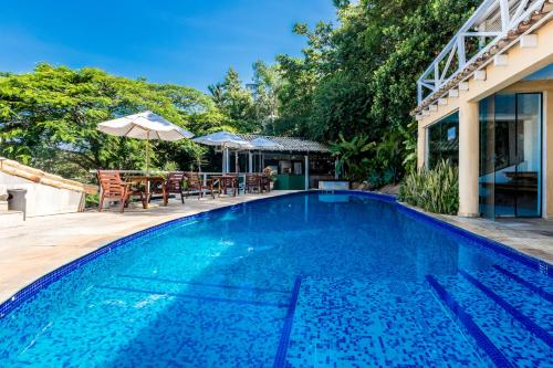 The swimming pool at or close to Pousada e Spa Villa Mercedes
