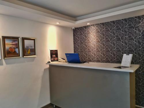 The lobby or reception area at Stay Inn