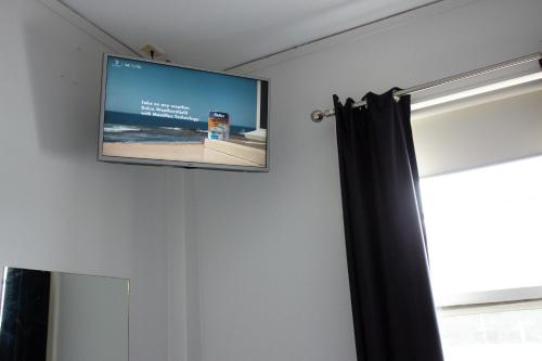 A television and/or entertainment center at Grand Hotel Rockdale