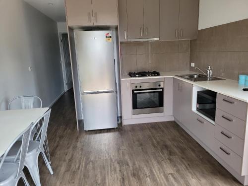 A kitchen or kitchenette at Bundalong Villas