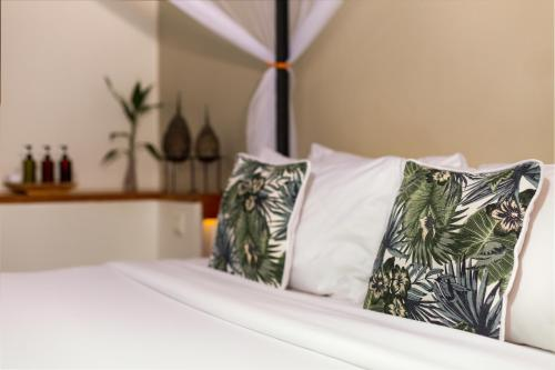 A bed or beds in a room at Plantation Urban Resort & Spa