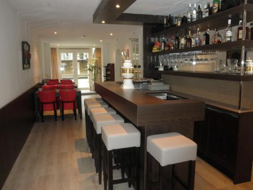 The lounge or bar area at Hotel Orion