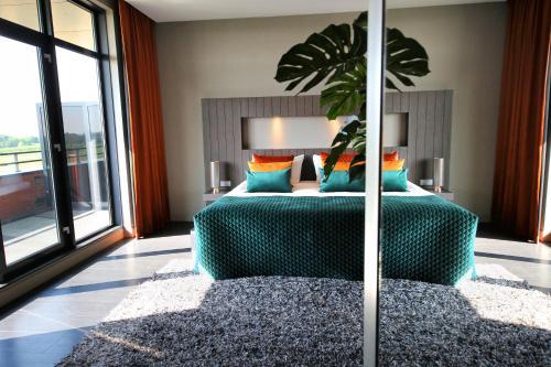 Een bed of bedden in een kamer bij Van der Valk Hotel Middelburg