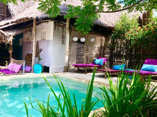 The swimming pool at or near Zanzistar Lodge