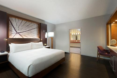 A bed or beds in a room at Walnut Creek Marriott