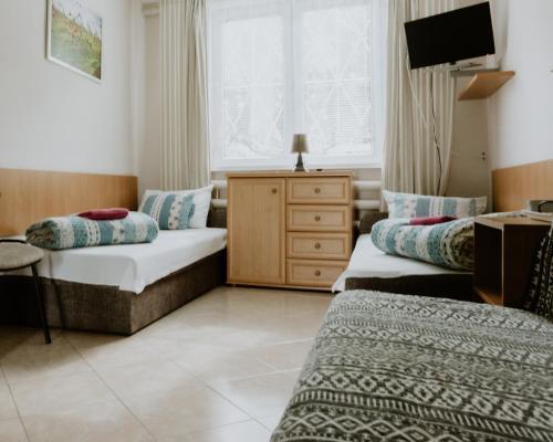Łóżko lub łóżka w pokoju w obiekcie Camping nr 61
