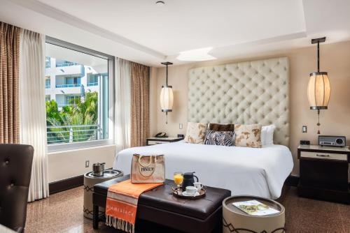 A bed or beds in a room at National Hotel, An Adult Only Oceanfront Resort