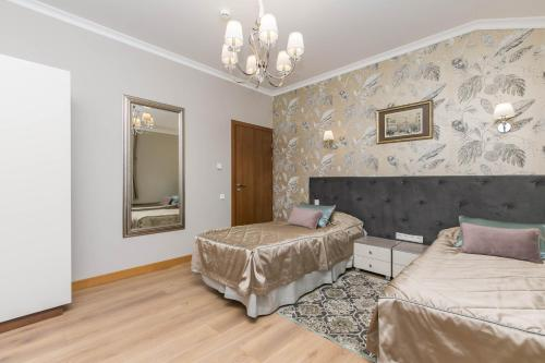 Кровать или кровати в номере Ладожская Усадьба