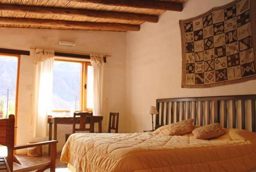 Una cama o camas en una habitación de Huaira Huasi