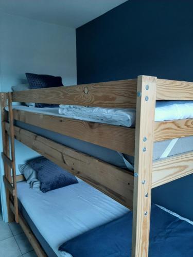 Ein Etagenbett oder Etagenbetten in einem Zimmer der Unterkunft Residentie Da Vinci Middelkerke