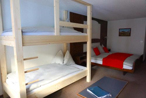 A bunk bed or bunk beds in a room at BaseCamp Hotel