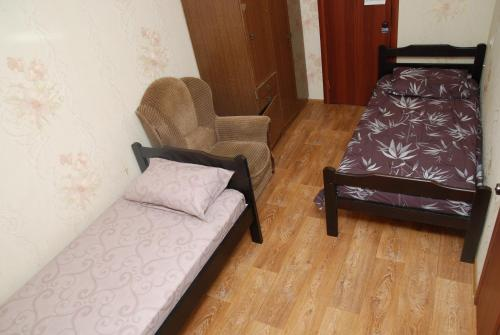 A bed or beds in a room at Воскресенск Апартаменты