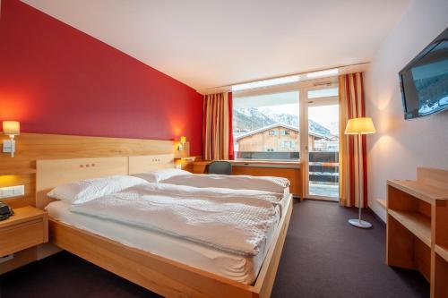 Ein Bett oder Betten in einem Zimmer der Unterkunft Hotel Gädi