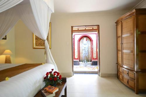 A bed or beds in a room at Tirta Ayu Hotel and Restaurant