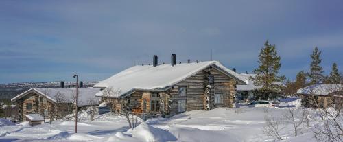 Sielikkö Aurora Log Apartments talvella