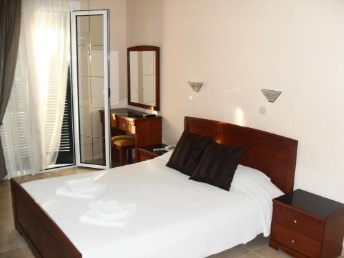 Un ou plusieurs lits dans un hébergement de l'établissement Hotel Pavlos - Studios
