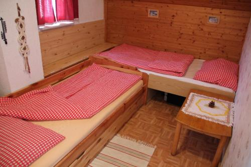 A bed or beds in a room at Mekina Guesthouse