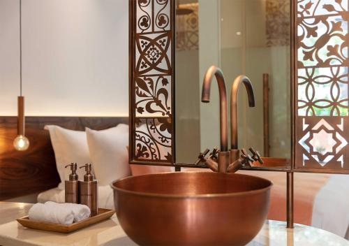 A bathroom at FCC Angkor by Avani