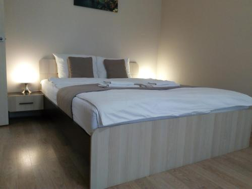 A bed or beds in a room at Apartment in center of Balashikha