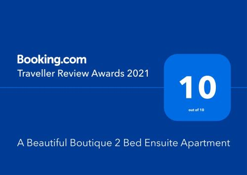 A certificate, award, sign, or other document on display at A Beautiful Boutique 2 Bed Ensuite Apartment