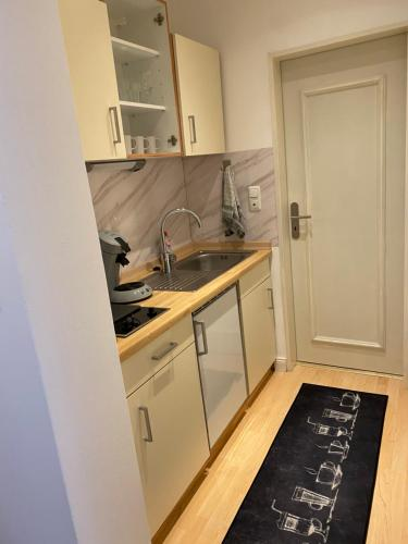 A kitchen or kitchenette at Wohnung im Herzen von Bad Salzuflen am Kurpark