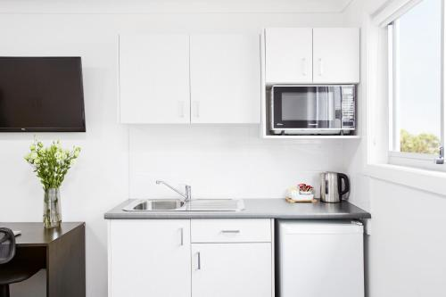 A kitchen or kitchenette at Aspire Newcastle