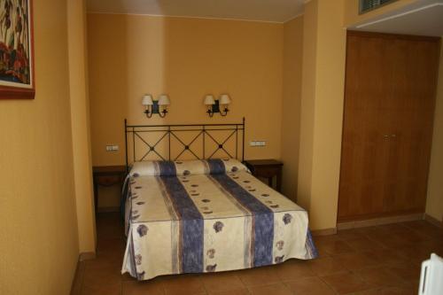 Een bed of bedden in een kamer bij Cal Mariner
