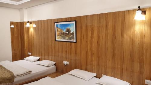 A bed or beds in a room at MPT Hotel Shubhim Highway Treat