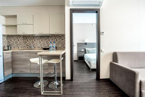 A kitchen or kitchenette at Ramada Hotel & Suites by Wyndham Novosibirsk Zhukovka