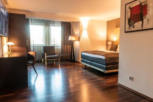 Ein Bett oder Betten in einem Zimmer der Unterkunft Mauritius Hotel & Therme