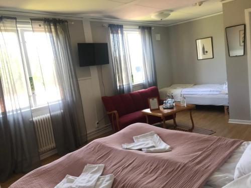 Säng eller sängar i ett rum på Gamla Gästgivaregården