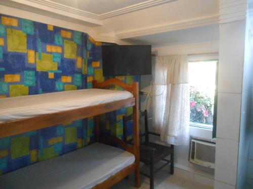 A bunk bed or bunk beds in a room at A meson Suites
