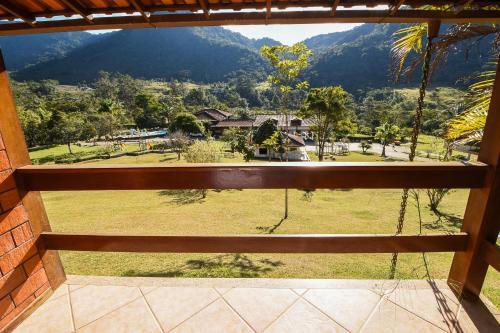 A balcony or terrace at Tarkna - hotel recanto das aguas