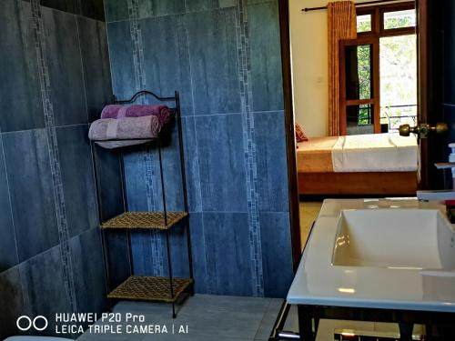 A bathroom at Serendib Village Guest House