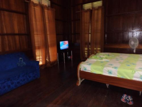 A bed or beds in a room at Me-Zochi Resort