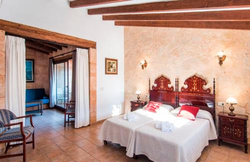 A bed or beds in a room at Finca Es Torrent