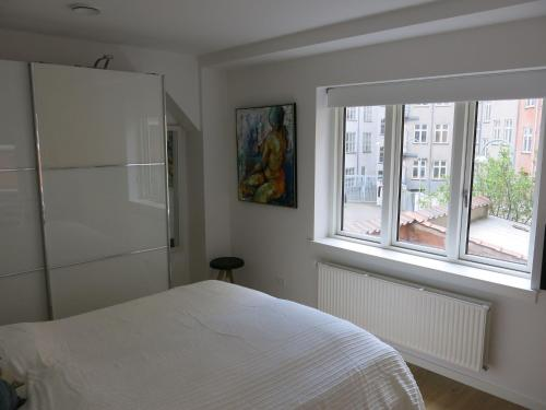 A bed or beds in a room at ApartmentInCopenhagen Apartment 768