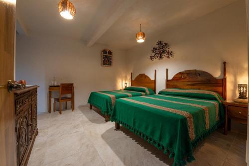 Cama o camas de una habitación en La Casa Carlota