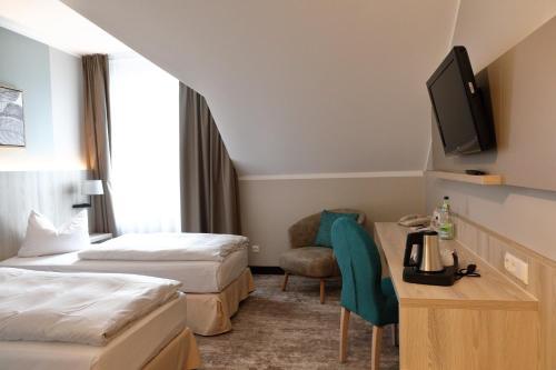 Ein Bett oder Betten in einem Zimmer der Unterkunft Best Western Erfurt-Apfelstädt