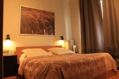 Cama o camas de una habitación en Buba House
